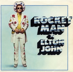 04-rocket-man-single-artwork-nudie-suit-timeline-bb11-style-2016-billboard-1000